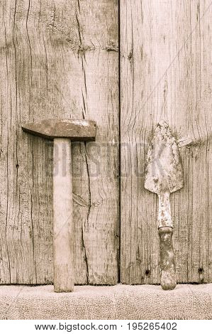 Old Rusty Hammer And Trowel