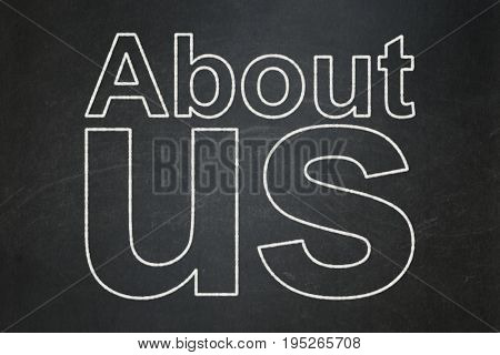 Advertising concept: text About Us on Black chalkboard background