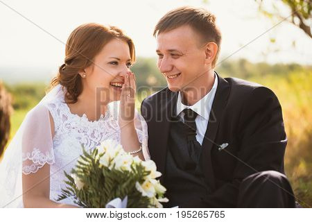 portrait of a couple bride and groom on the background of field.