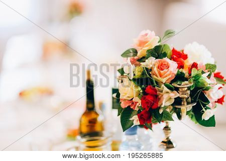 multi colored flowers on the wedding table.