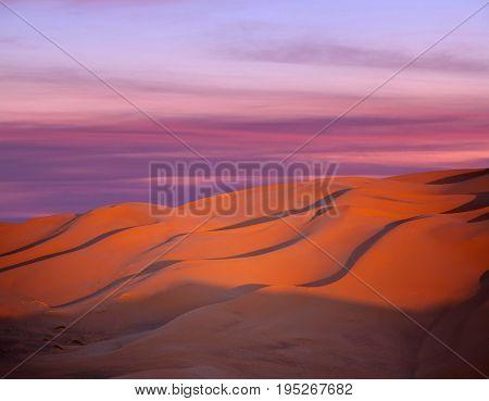 Sand dunes at sunset in Sahara desert in Morocco, Africa