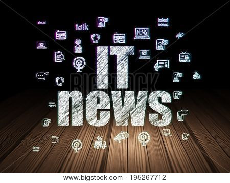 News concept: Glowing text IT News,  Hand Drawn News Icons in grunge dark room with Wooden Floor, black background