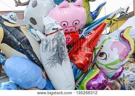 Agno, Switzerland - 12 March 2016: Colorful inflated balloons selling at a market