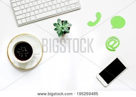 customer support service desktop with email signs on white office background top view mock-up