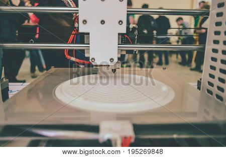 The process of working 3D printer and creating a three-dimensional object. Progressive modern additive technology