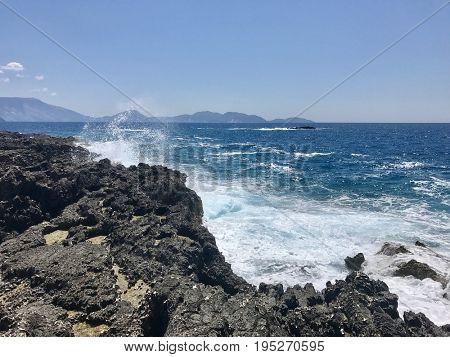 Waves crashing on rugged rock coastline of the Ionian Sea on the island of Kefalonia, Greece
