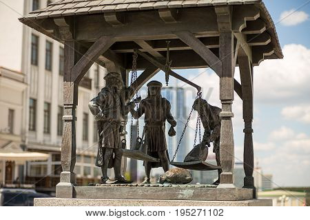 Minsk republic of Belarus-bronze statue medieval merchants weigh goods on the central square of the old city May 2016