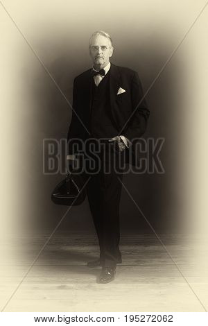 Antique Plate Photo Of Vintage 1920S Doctor In Black Suit With Bow Tie. Holding Handbag.
