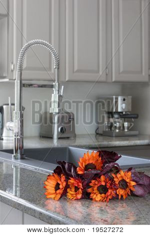 orange sunflowers on the counter in a modern kitchen