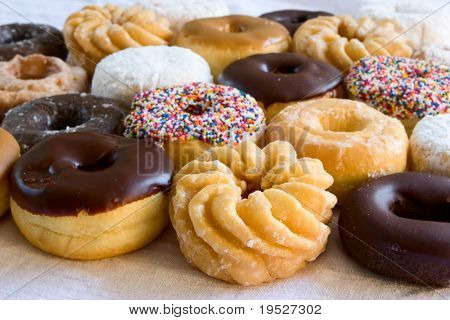 assortment of fresh donuts - focus on front donut