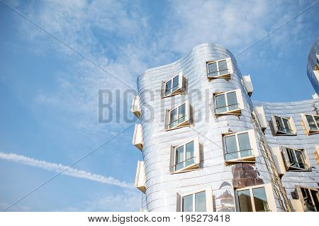 DUSSELDORF, GERMANY - July 04, 2017: Architectural fragment of Neuer Zollhof complex designed by Frank Gehry architects on the waterfront of the Media Harbour in Dusseldorf