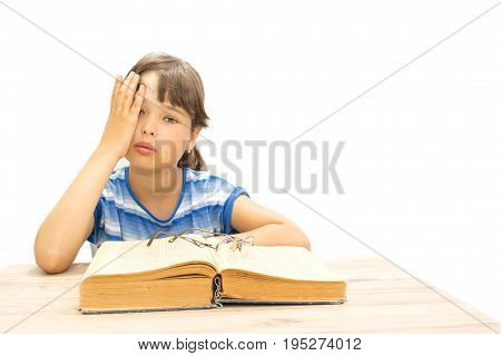 teenager with book on a white background fatigue and sadness in his eyes.