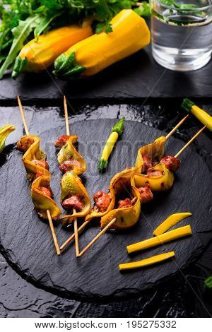 Yellow Zucchini And Chicken Kebab On Wooden Stick On Black Stone Slate Plate. Close Up.