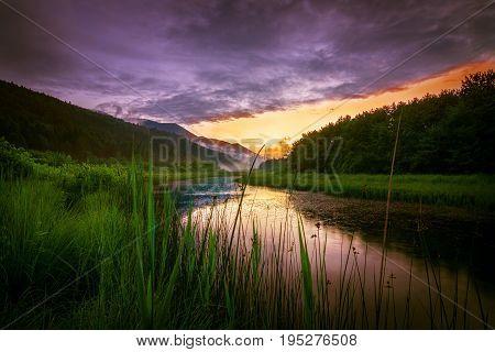 Sunset over the Ribnica river in Slovenia