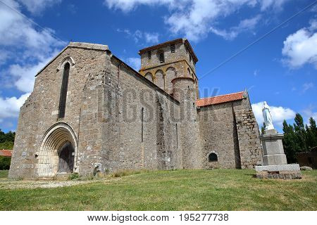 Vieux Pouzauges Church with a statue of Virgin Mary on the right side, Pouzauges, Vendee, France