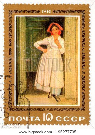 UKRAINE - CIRCA 2017: A postage stamp printed in USSR shows picture Albanian girl in doorway created by the artist A.A. Ivanov from the series Russian Paintings circa 1981