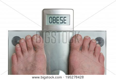 Man's Feet On Weight Scale - Obese