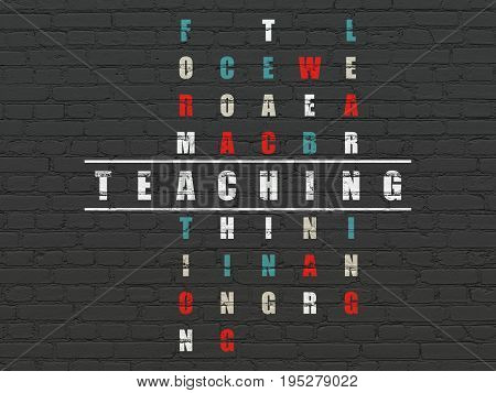Education concept: Painted white word Teaching in solving Crossword Puzzle