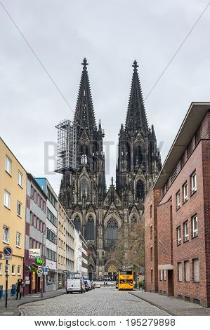 COLOGNE GERMANY - FEBRUARY 22 2016: Cologne Cathedral (officially High Cathedral of Saint Peter) is a Roman Catholic cathedral in Cologne Germany. It is Germany's most visited landmark and currently the tallest twin-spired church