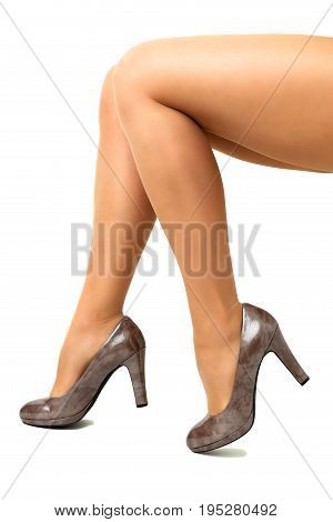 Long pretty woman legs isolated on white background