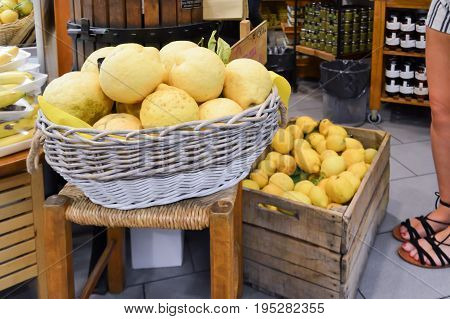 Basket and crate of lemons in limone from italien