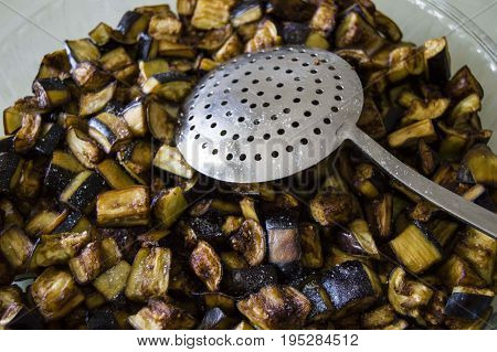 Chopped and fried eggplant pieces for eggplant meal