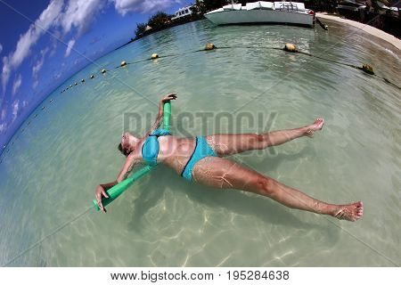 Adult woman enjoying summer in the pool