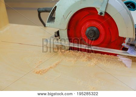 Carpenter Using Circular Saw Cutting Wooden Board In Wood Workshop.
