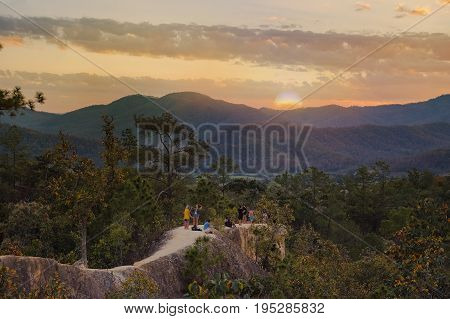 beautiful sunset in the mountain landscapesreflection of sky and mountainsThe hills with nightfall landscapemajestic sundown mountthe tourist waiting for sunset at Pai CanyonChiang RaiThailand