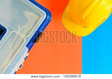 Yellow Safety Helmet And Construction Materials On Paper Blue And Orange
