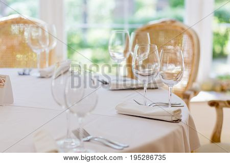 A decorated table in the restaurant on wedding ceremony