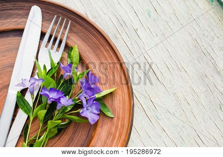 Festive Table setting with delicate purple flowers. Holiday Table Set for Mother's Day or Birthday. Selective Focus.