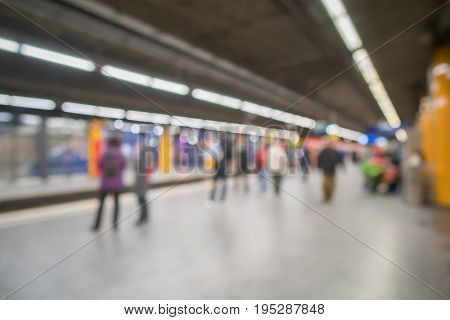 Blurred Image Bokeh Of People In Munich Subway Station.