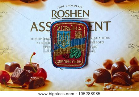 ILLUSTRATIVE EDITORIAL.Chevron of Ukrainian Army. With logo Roshen Inc. Trademark Roshen is property of Ukrainian president Poroshenko. Kiev,Ukraine.July 11, 2017