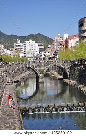 Nagasaki, Japan - April 6, 2014:Megane Bridge or Spectacles Bridge is an old stone arch bridge constructed over the Nakashima River in Nagasaki, Kyushu, Japan. The bridge was originally built in 1634.