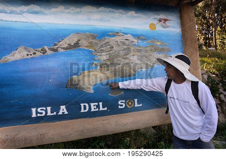 MAY 27 2015 TITIKAKA LAKE ISLA DEL SOL BOLIVIA Local Guide shows the entrance to the Yumani comminuty in the island.