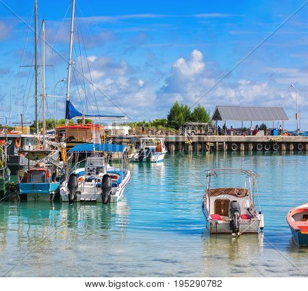 View of the marina  of boats in beautiful sunny morning,  La Passe, La Digue Island, Seychelles
