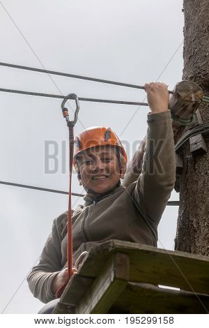 Happy Romanian Tourist Woman On Course In Retezat Mountains Helmet And Safety Equipment