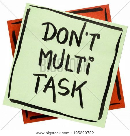 do not multitask -  efficiency advice or reminder - handwriting on an isolated sticky note
