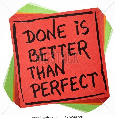 Done is better than perfect reminder - handwriting in black ink on an isolated sticky note