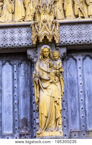 LONDON, ENGLAND - JANUARY 16, 2017 Mary Statue Door Facade Westminster Abbey Church London England. Westminister Abbey has been the burial place of Britain's monarchs since the 11th century and is the setting for many coronations and weddings.