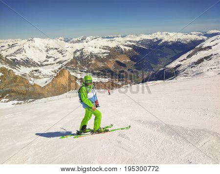 Freeride Skier With Rucksack Running Downhill In Freeze Motion On The Slope In HinterTux Austria