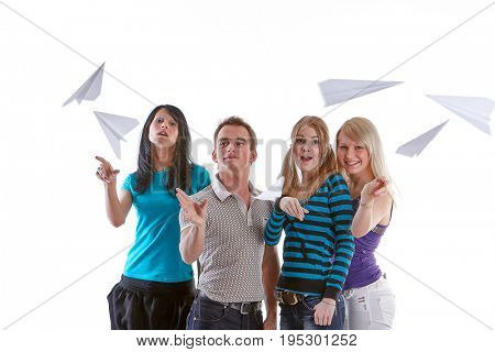 Group of young happy people with paper planes on a white background.