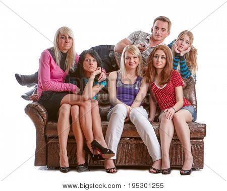 The group of young people sits on a sofa and watches TV on a white background.