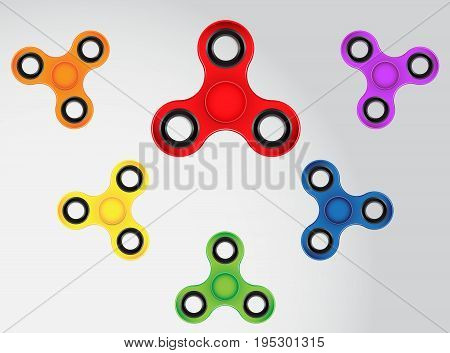 Six multi-colored spinners on a gray background