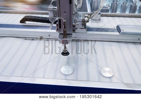robot with vacuum suckers picks the item from the conveyor in manufacture factory