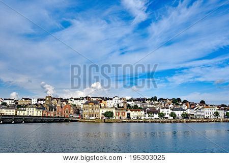 Bideford North Devon England 13th July 2017 - The quay and old bridge in the port of Bideford in North Devon England taken from Wooda Wharf looking west acfross the river Torridge