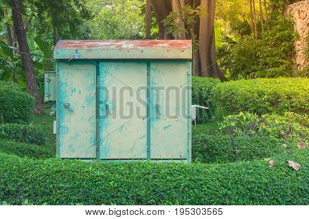 Light control cabinet with green natural background in public park. (Autumn filter effect)