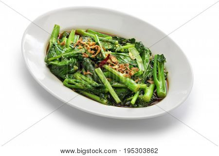 stir fried chinese kale(chinese broccoli) with oyster sauce isolated on white background