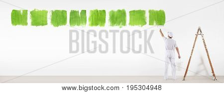 painter man painting green color symbol isolated on blank white wall background ecology concept
